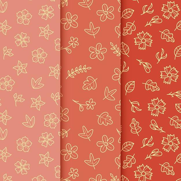 赤の背景に黄金の葉手描き春パターン 無料ベクター