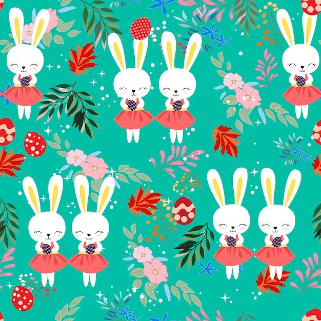 花フレームのシームレスなパターンでかわいい赤ちゃんイースターのウサギ Premiumベクター