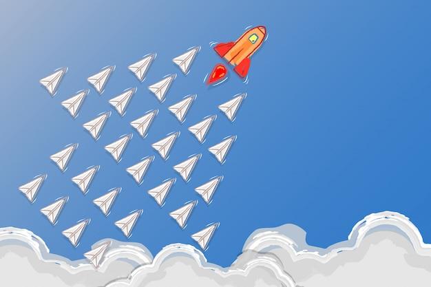 Концепция лидерства, сыгранности и смелости, ракеты для руководителя и бумажных самолетов следуют за лидером ракеты на небе. Premium векторы