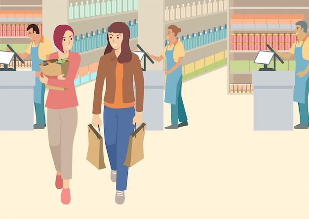 Две женщины разговаривают в супермаркете Premium векторы