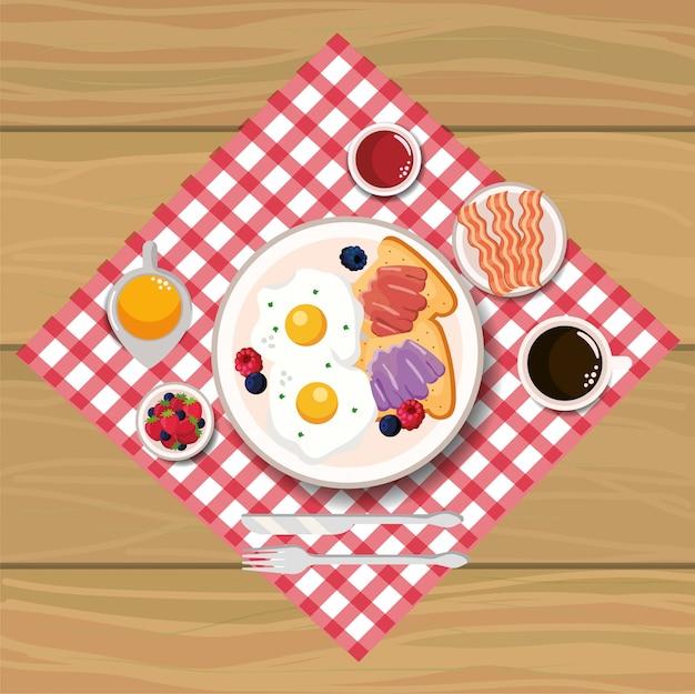 Вкусные жареные яйца с беконом и нарезанным хлебом Premium векторы