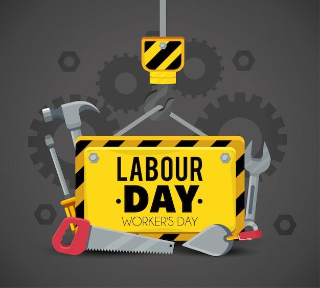 Эмблема со строительными инструментами к трудовому празднику Premium векторы