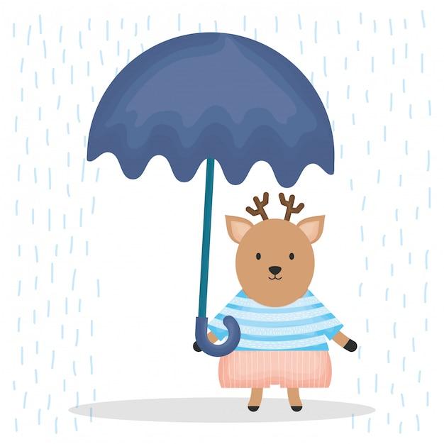 傘のキャラクターとかわいいトナカイ Premiumベクター