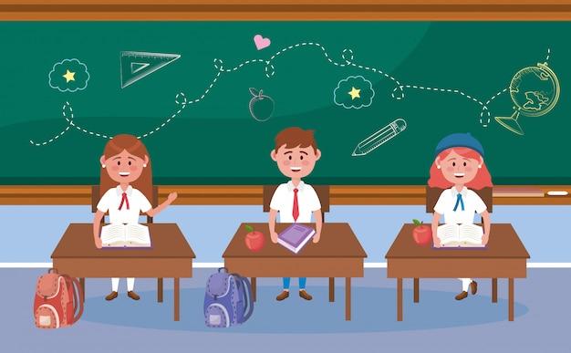Девочки и мальчики за партой с книгой и яблочными фруктами в школу Бесплатные векторы
