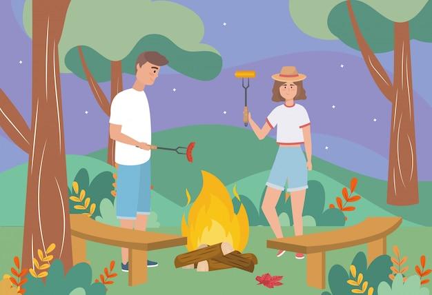 男と女のソーセージと穂軸の薪の火 無料ベクター