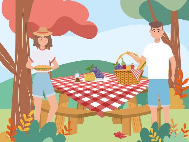 Женщина и мужчина пара с виноградом и сыром Бесплатные векторы