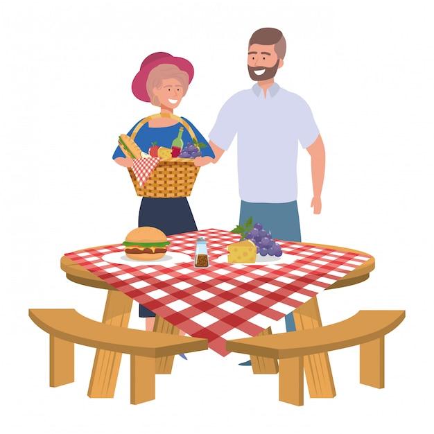 Пара женщина и мужчина, пикник Premium векторы