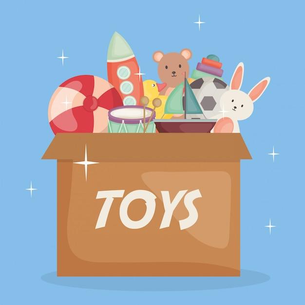 カートンボックスの中の赤ちゃんのおもちゃ Premiumベクター