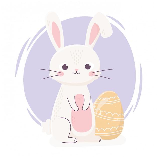 黄色の卵と幸せなイースターかわいいウサギ Premiumベクター