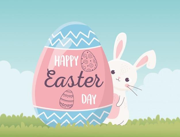 ハッピーイースターかわいいウサギと卵のレタリング装飾、グリーティングカード Premiumベクター
