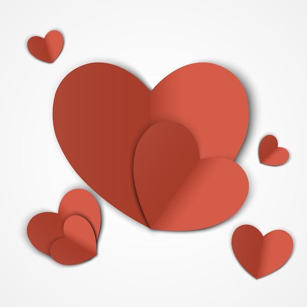 バレンタイン・デー。カット紙のハートと抽象的な背景。図 Premiumベクター