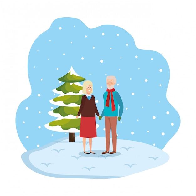 祖父母、冬の服を着た雪景色 Premiumベクター