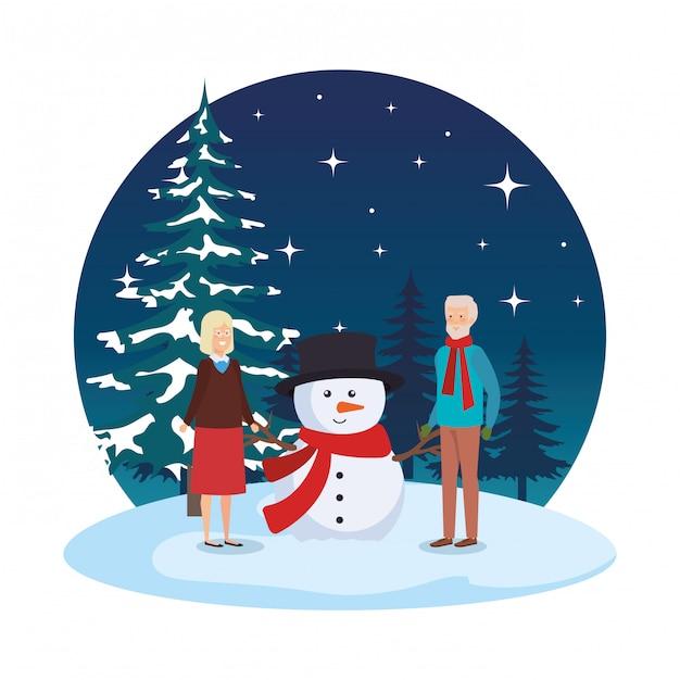 雪景色の雪だるまの祖母カップル Premiumベクター