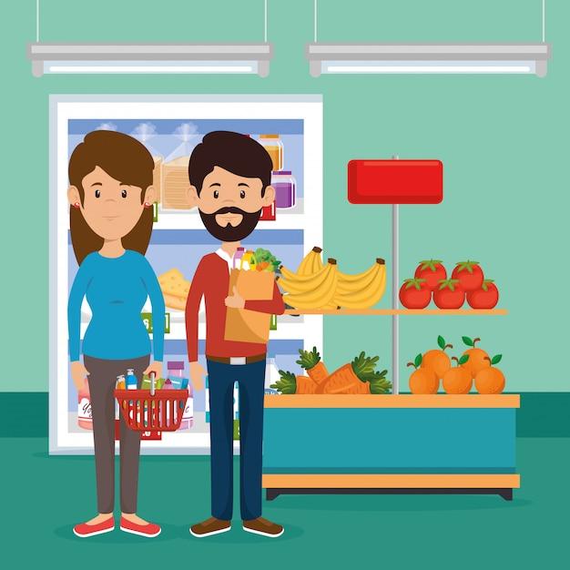 スーパーマーケットの食料品とカップルします。 無料ベクター