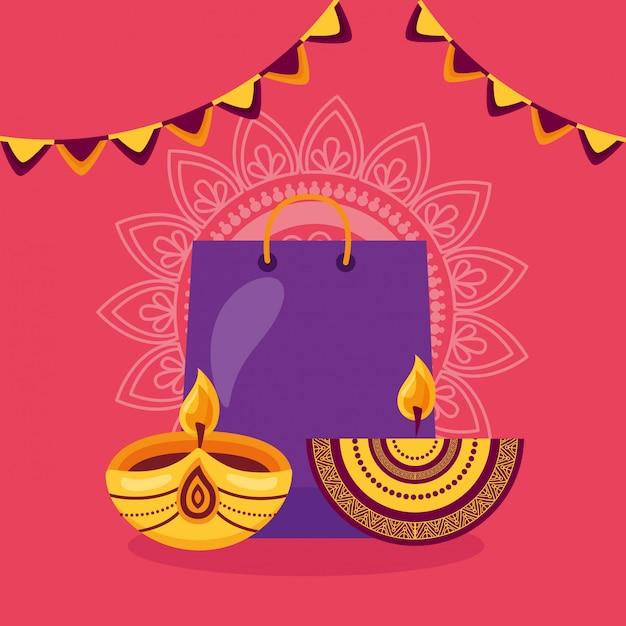 ショッピングバッグとキャンドルでハッピーディワリ祭カード 無料ベクター