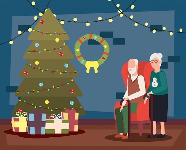 クリスマスの装飾のあるリビングルームで祖父母のカップル 無料ベクター