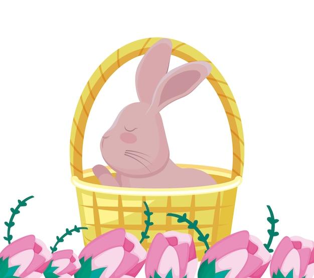 Милый кролик в плетеной корзине с цветами Premium векторы