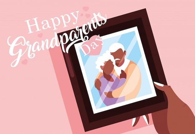 老夫婦の写真と幸せな祖父母の日のポスター Premiumベクター