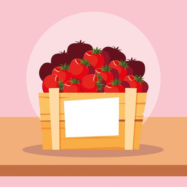 木製の箱で新鮮な赤いトマト野菜 Premiumベクター