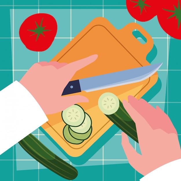 Руки шеф-повара с ножом и кухонной доской Premium векторы