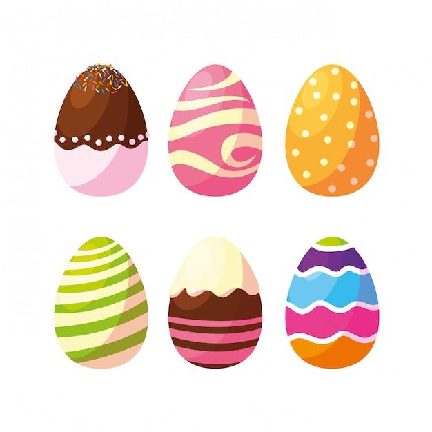 Набор украшенных пасхальных яиц с конфетами Premium векторы