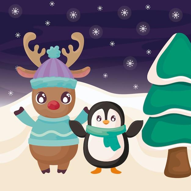 冬の風景にペンギンとトナカイ Premiumベクター