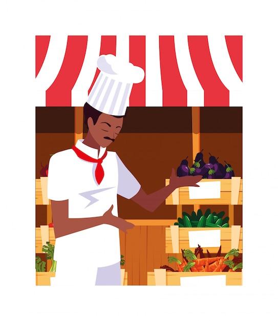 Мужчина готовит, повар в белой форме Premium векторы
