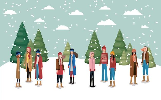 冬の服を着た雪景色の女性グループ Premiumベクター