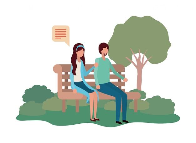 スピーチの泡と公園の椅子に座っているカップル Premiumベクター