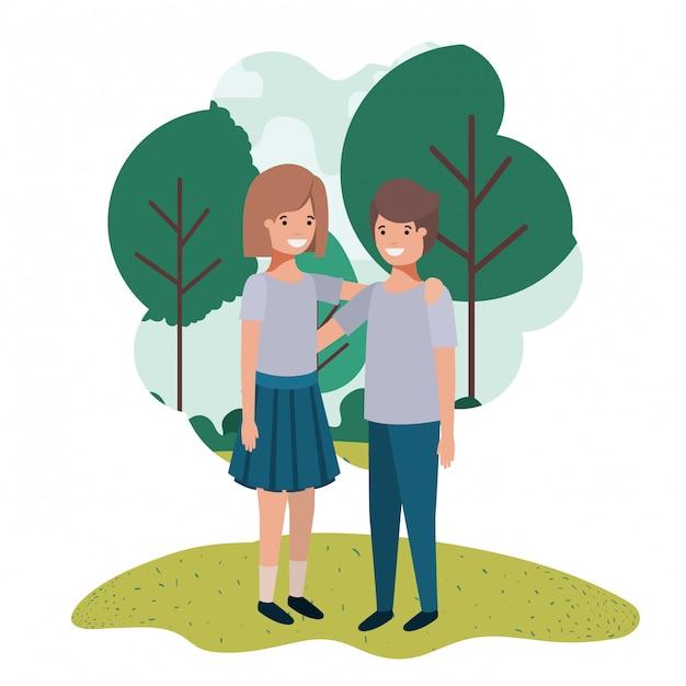 公園でフレンドリーなティーンエイジャーのカップル Premiumベクター
