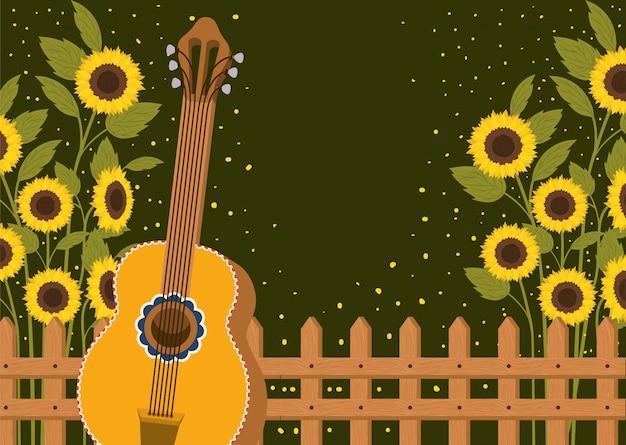 フェンスとギターの美しいひまわり畑 Premiumベクター