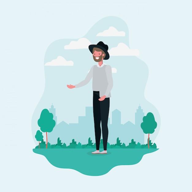 Молодой человек с бородой и шляпой, стоя в парке характер Бесплатные векторы