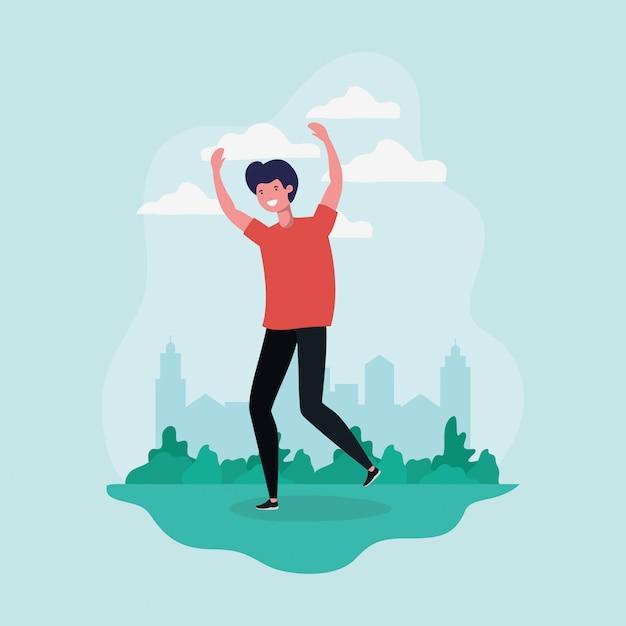 Молодой человек прыгает, празднуя в парке характер Бесплатные векторы