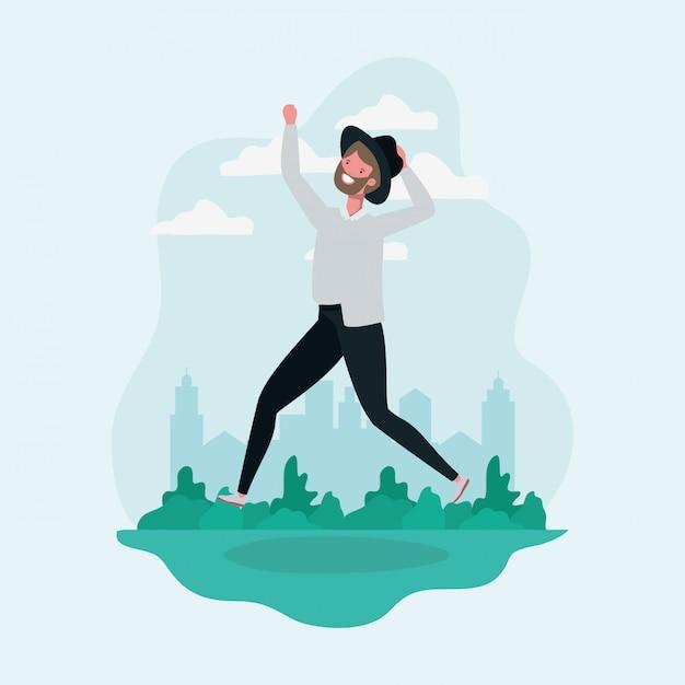 ひげと帽子が公園の文字でジャンプを持つ若者 無料ベクター