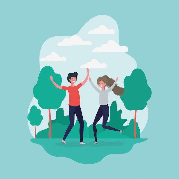 Молодая пара прыгает, празднуя в парке персонажей Бесплатные векторы