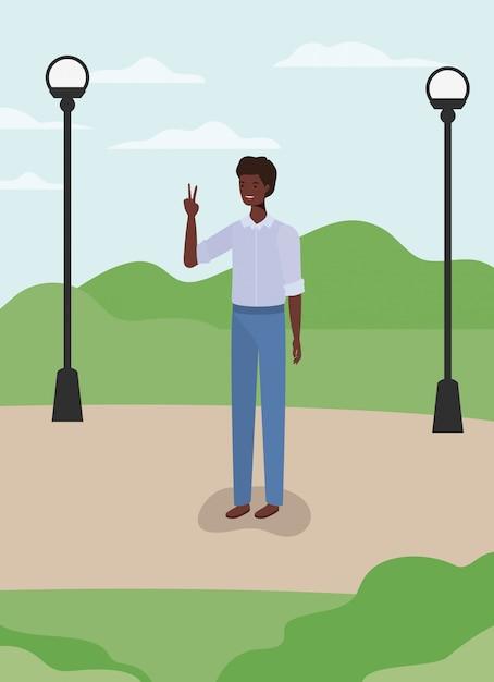 公園で若くてカジュアルなアフロ男 Premiumベクター