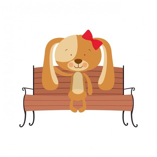 公園の椅子に座っているかわいい犬 Premiumベクター