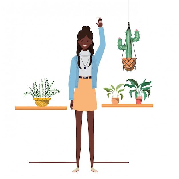 観葉植物とマクラメハンガーを持つ女性 Premiumベクター