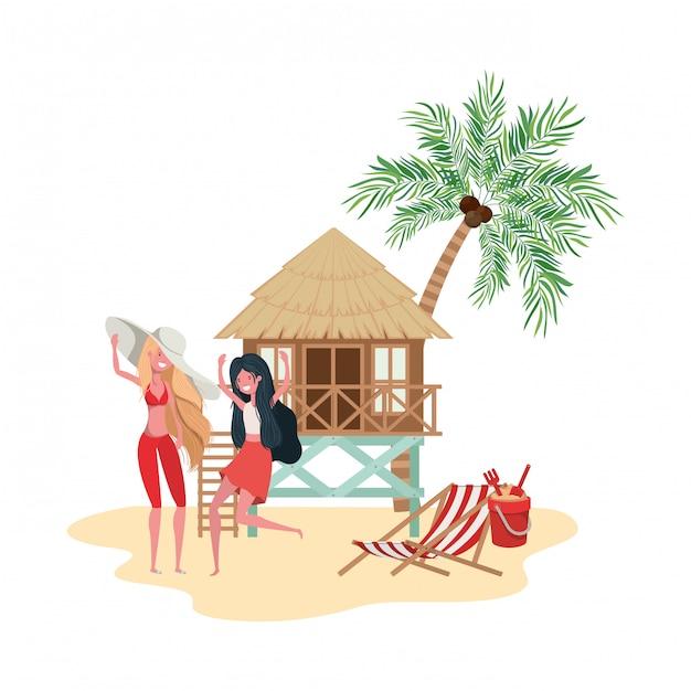 ビーチハウスとビーチに立っている女性 Premiumベクター