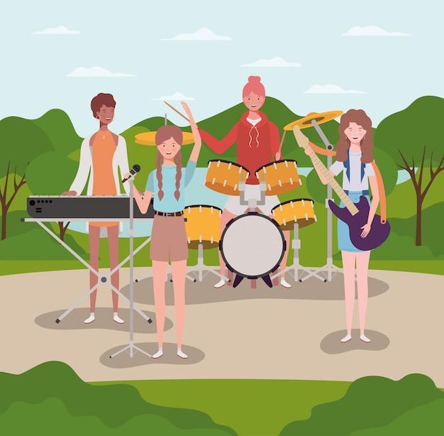 キャンプで楽器を演奏する女性のグループ Premiumベクター