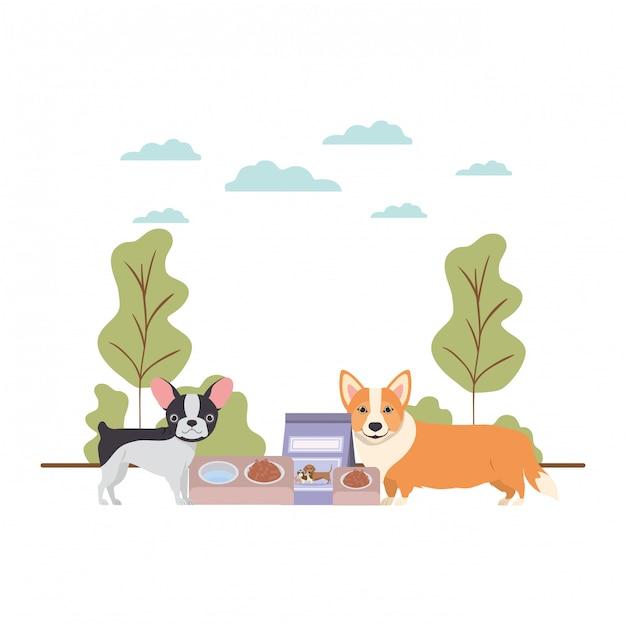 Собаки с миской и кормом для животных на пейзаже Premium векторы
