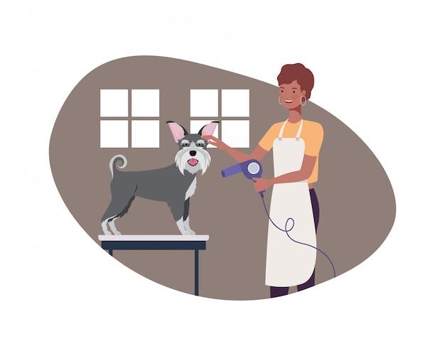 ペットトリマーで犬を持つ若い女性 Premiumベクター