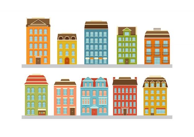 近代的な多階建ての建物のセット。市内の住宅。ドア、窓、バルコニー付きの家の正面。図。 Premiumベクター