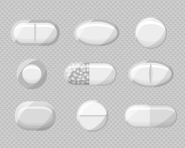 Набор реалистичные таблетки волдыри с таблетками и капсулами. Premium векторы