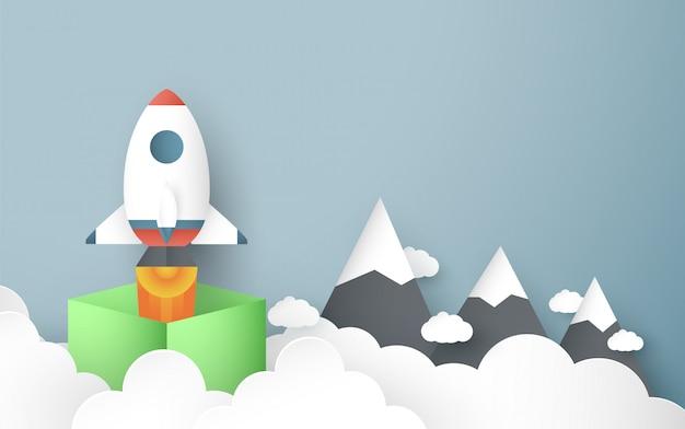 Иллюстрация с запуском концепции в стиле бумаги вырезать, ремесло и оригами. ракета летит на голубое небо. Premium векторы