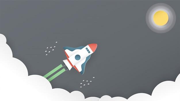 カット紙、クラフト、折り紙スタイルのコンセプトを起動するとイラスト。ロケットが飛んでいます。 Premiumベクター