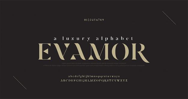エレガントで豪華なアルファベット文字フォントと番号。古典的なレタリング最小限のファッションデザイン。 Premiumベクター
