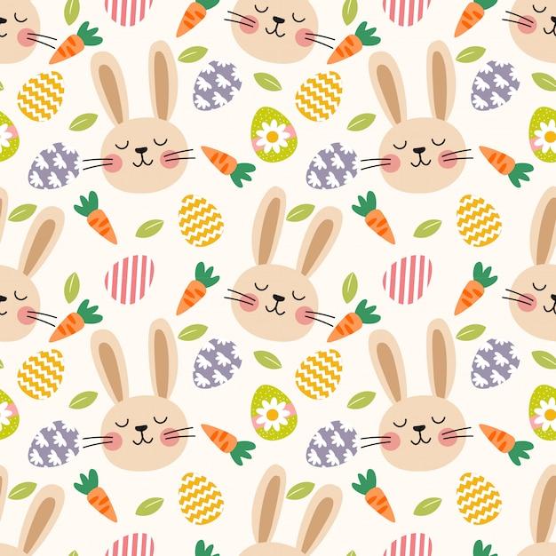 かわいいウサギとイースターエッグのシームレスパターン。 Premiumベクター