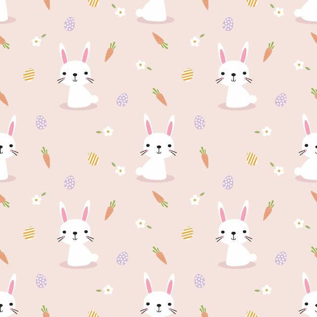 かわいい白ウサギとイースターエッグのシームレスパターン。 Premiumベクター