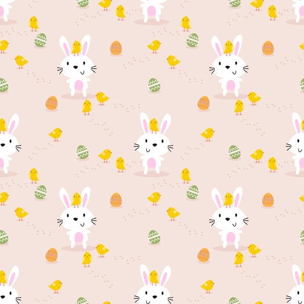 かわいい白ウサギ、小さなひよこ、イースターエッグのシームレスパターン。 Premiumベクター